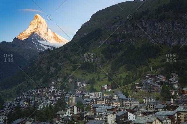 The first sun light on the Matterhorn, a famous mountain above Zermatt, a town in the Swiss Alps.