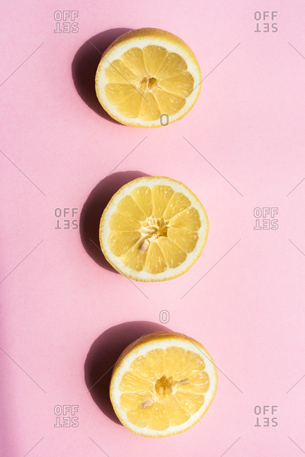 Lemons on pink background