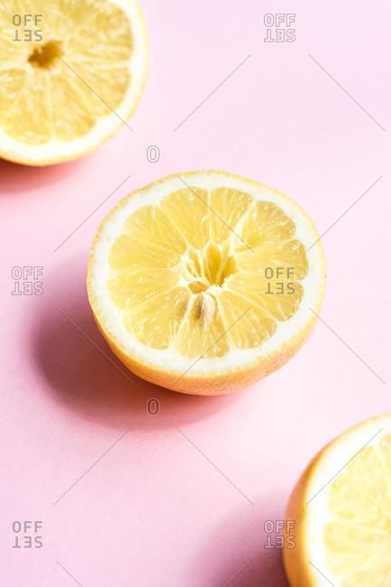 Close up of lemons on pink background