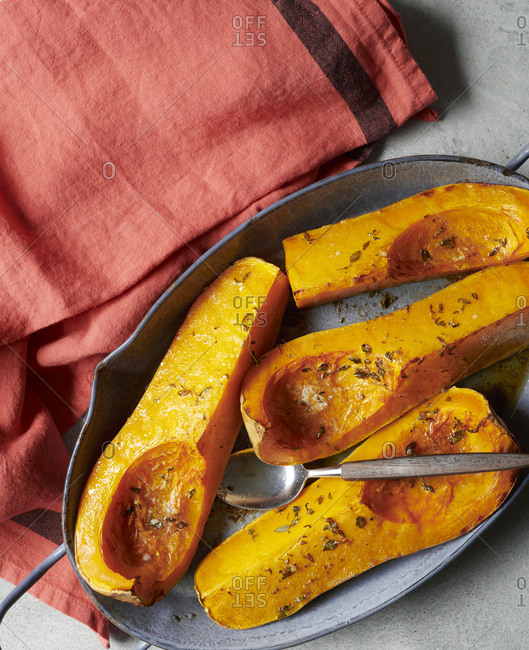 Roasted squash by red towel
