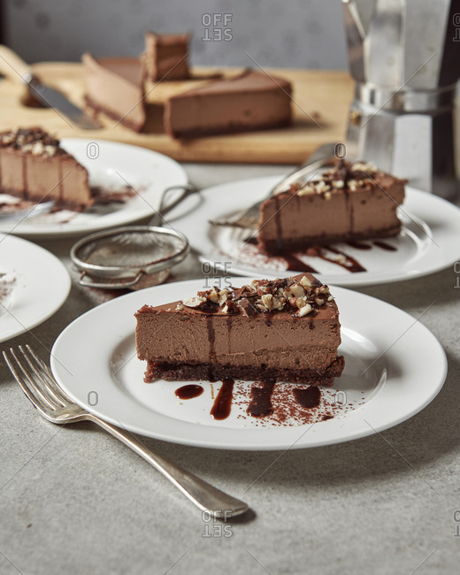 Table with servings of chocolate and hazelnut cheesecake