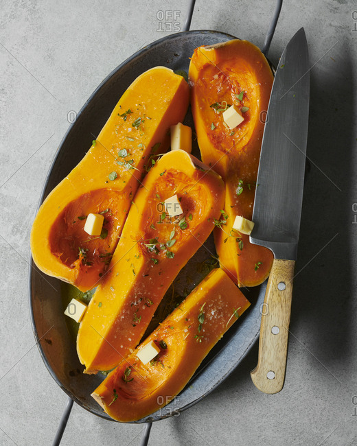 Roasted squash in oven dish with knife