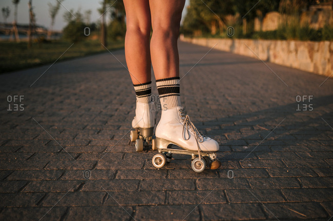 Legs of woman skating with roller skates