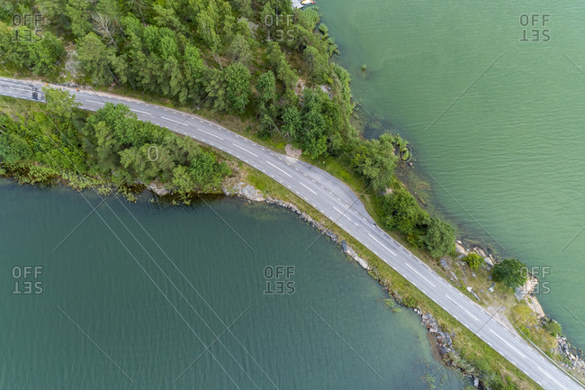 Aerial shot of a road by the water