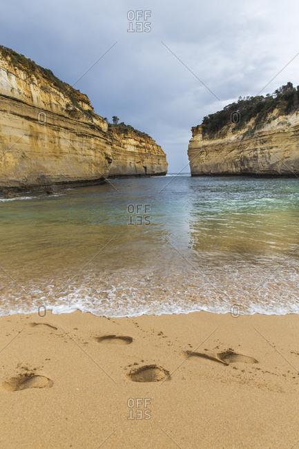Sandy Footprints next to the ocean