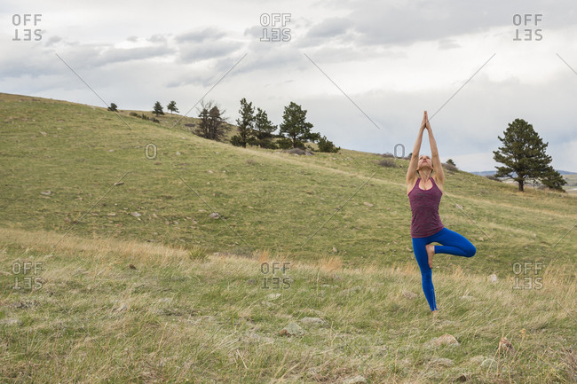 Athletic young female practices yoga outside in Boulder, Colorado