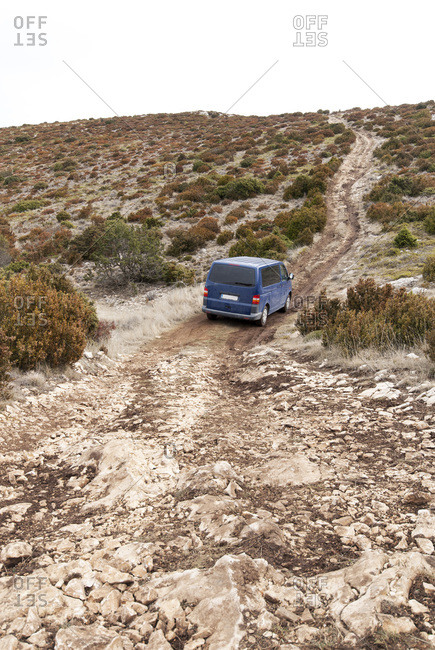 Van driving along dirt road, Montsec, Mont-Rebey, Catalonia, Spain