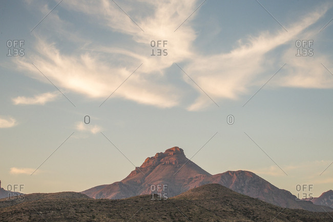 Mountain Range In The Distance Under A Softly Glowing Dawn Sky