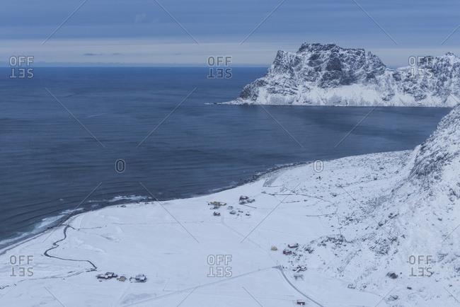 Winter view over snow covered Uttakleiv beach from summit of Mannen, ۢ��y, Lofoten Islands, Norway