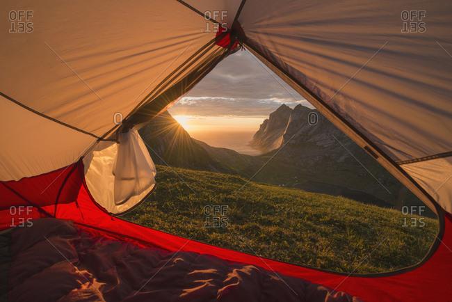 Sunset over Bunes beach from inside tent