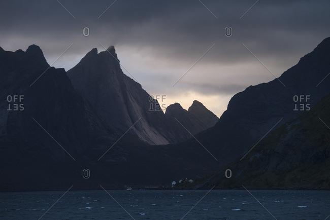 Scenery with Breiflogtind mountain rising above Kjerkfjord