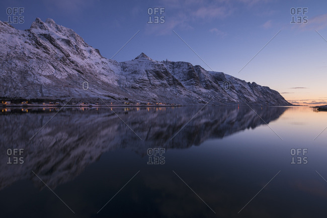 Skjelfjord scenery with mountains on coastline in winter at sunset