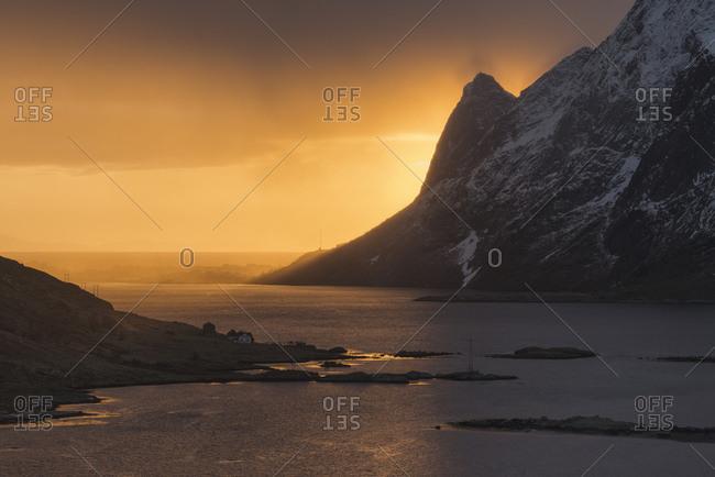 Winter sunrise over Reine and Reinefjord, Vindstad, Moskenesoya, Lofoten Islands, Norway