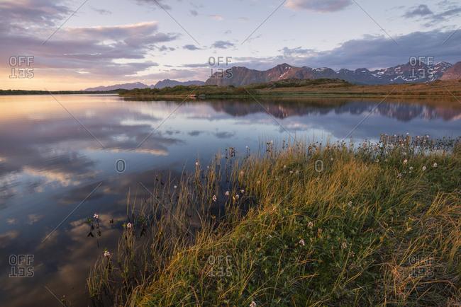 View of lake at sunset, Gimsoy, Lofoten, Norway