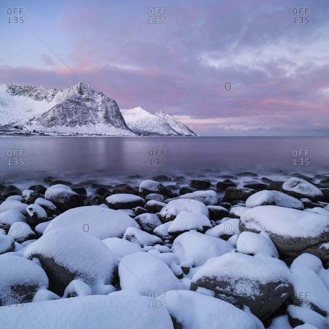Snow covers rocky coastline at Steinfjord, Senja, Norway