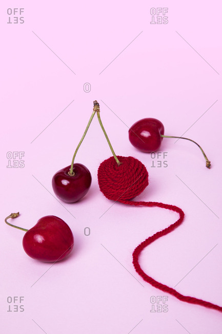 Red cherries one wrapped in yarn