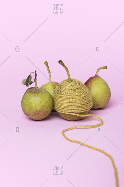 Four pears one wrapped in yarn