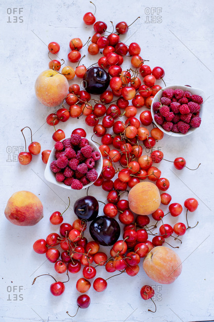 Various fresh fruits and berries: cherries, raspberry, peaches