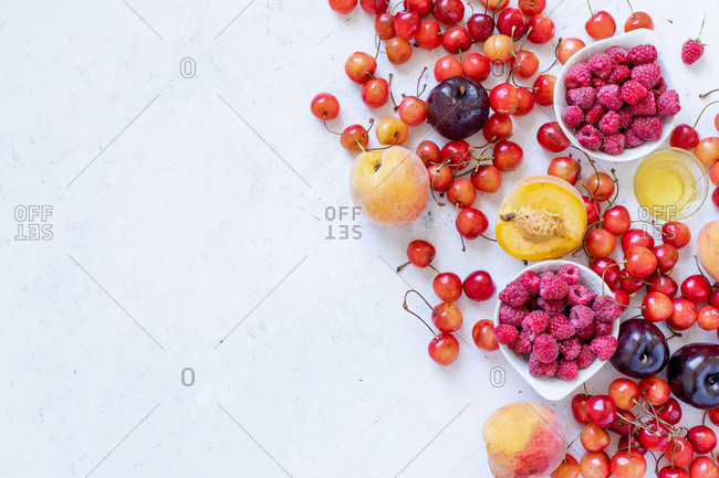 Various fresh fruits and berries with copy space