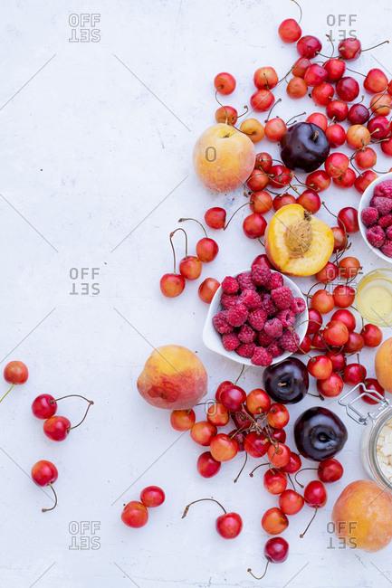 Variety of fresh fruits and berries: cherries, raspberry, peaches