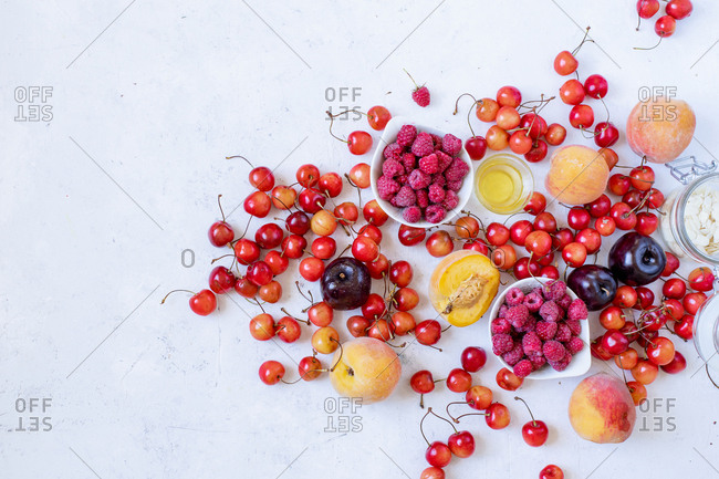 Variety of fresh fruits and berries and copy space