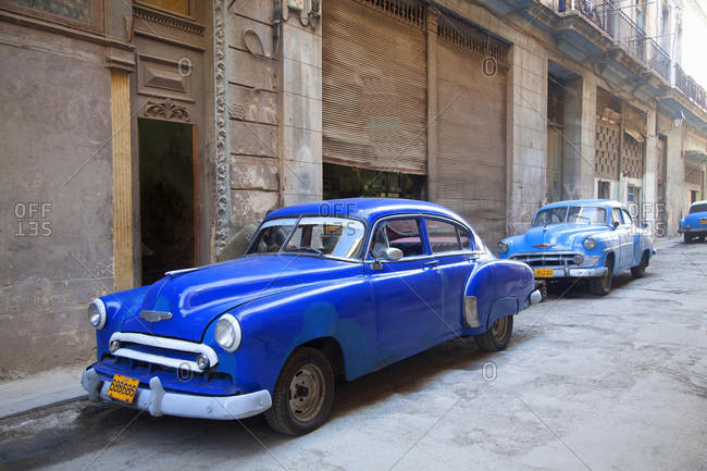 Havana, Cuba - January 25, 2010: Old cars parked in city center
