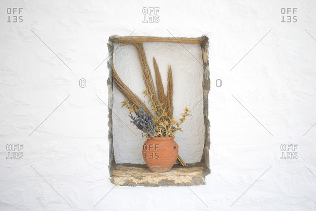 Old style vase decoration in cafe wall, Folegandros Island, Cyclades, Greece