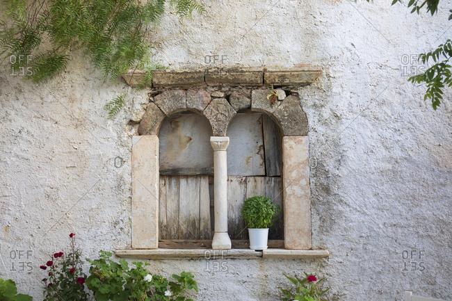 Old broken down window opening, Folegandros Island, Cyclades, Greece