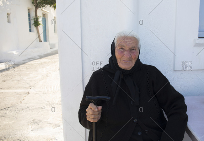 Folegandros Island, Cyclades, Greece - June 1, 2019: Portrait of an old lady