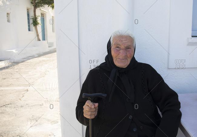Folegandros Island, Cyclades, Greece - June 1, 2019: Portrait of an old lady