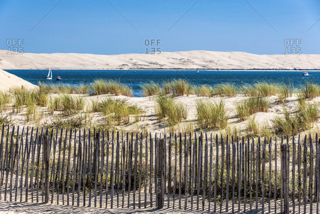 France, Gironde, Arcachon bay, Pointe du Cap-Ferret, beach closed by a barrier (Barriere girondine), and view on the Dune of Pilat