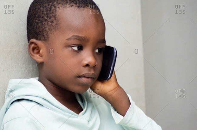 Child listening with great attention that his mother told him on the phone.