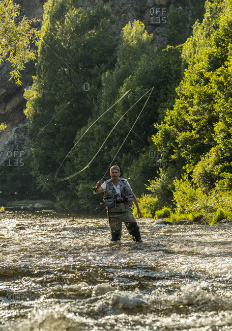 AuvergneRhone-AlpesHaute-LoireFly fishing in the valley of the Haute-Loire. A fisher casting his fishing rod.