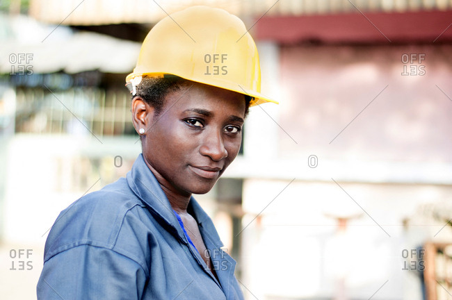 Portrait of a young worker in her workplace.