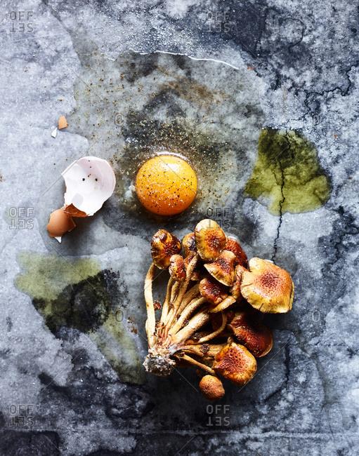 Chestnut mushrooms and a broken egg