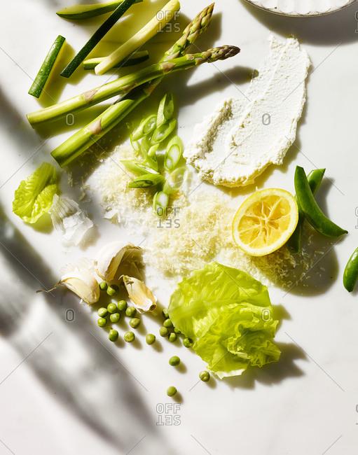 Variety of green vegetables on white background