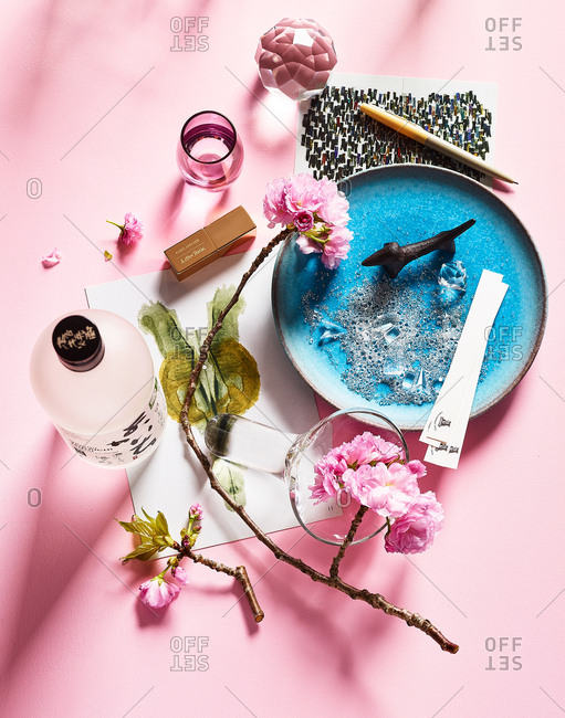 Paris Atelier make-up laid out with saki flowers and soap in a dish.