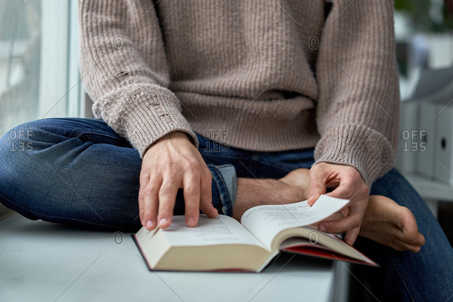 Close up of man reading a book