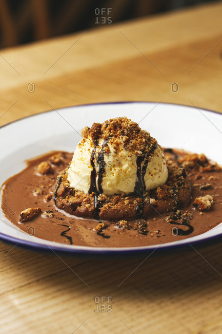 Tasty sweet burger with chocolate crumb and nuts