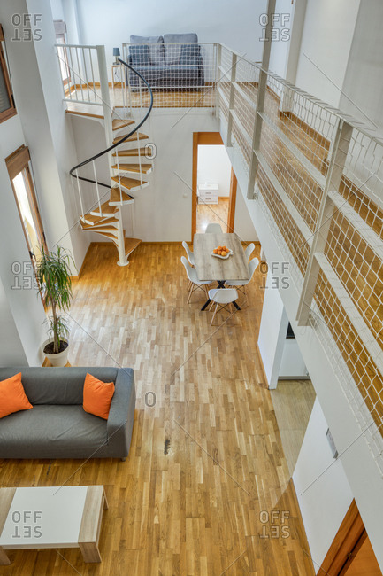 Top view of empty duplex apartment in simple minimalist style with modern cozy furniture
