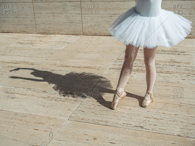 Ballerina standing on tiptoe classical position outside