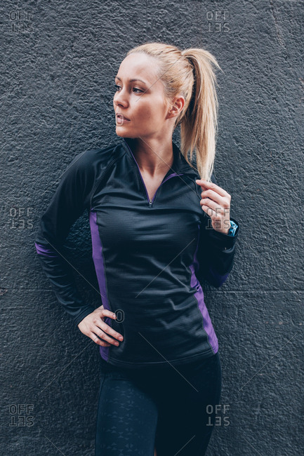 Portrait of a young blonde caucasian woman with sportswear outdoors