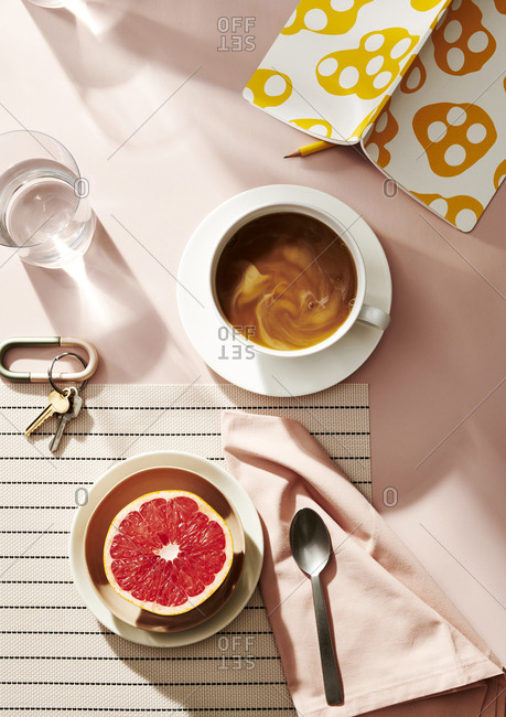 Overhead view of a healthy morning breakfast with grapefruit and coffee