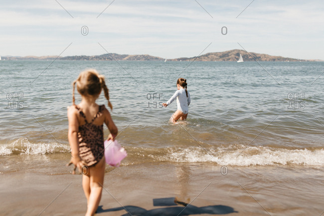 Two girls swimming at East Beach in San Francisco, California