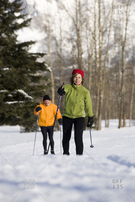 Canada, British Columbia, Fernie - January 6, 2007: Couple x-c skiing on groomed ski trails.