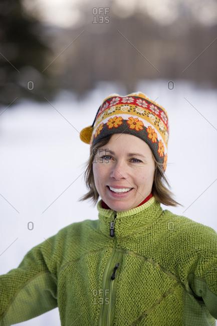 Woman at trailhead of xc ski trails.