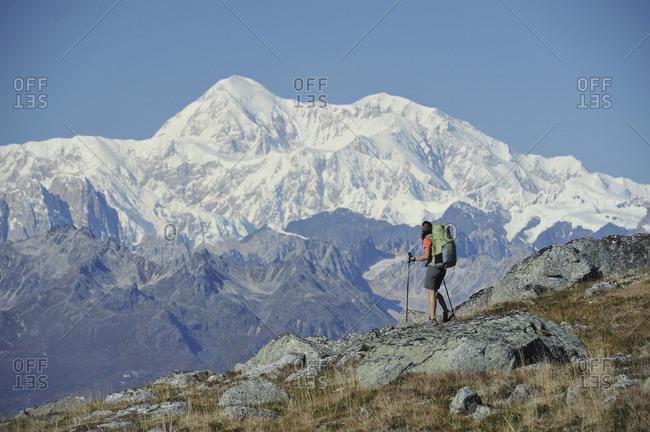 Backpacker hikes Kesugi Ridge Trail in Denali State Park, Alaska.
