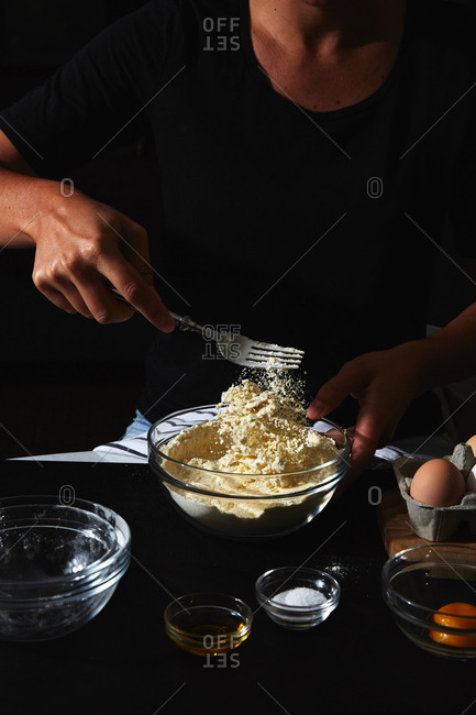Person mixing dough for pasta