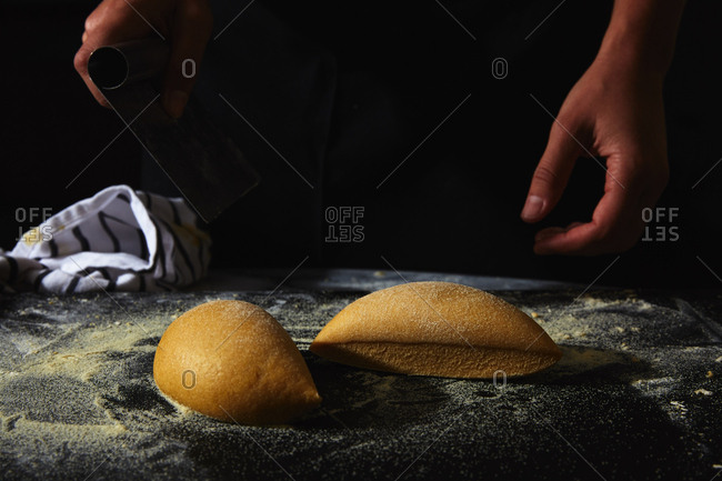 Person cutting dough for pasta