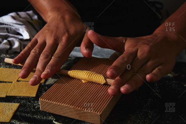 Person rolling dough for textured pasta